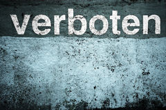 Forbidden. Concrete wall with grunge texture stylized into a duotone palette. Contains a german word verboten which means forbidden stock photos