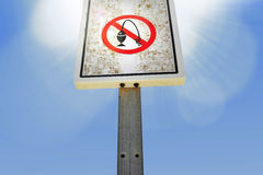 Forbidden fishing or not not fish sign on wooden pole prohibited signal under blue sky Stock Images