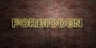 FORBIDDEN - fluorescent Neon tube Sign on brickwork - Front view - 3D rendered royalty free stock picture Royalty Free Stock Photography