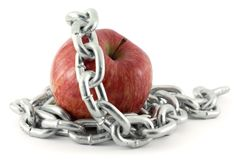 Forbidden Fruit. Apple in chains over white Stock Photo