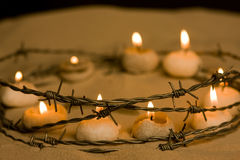 Forbidden hope. Burning candles in barbed wire, symbol of hope and civil rights stock photos