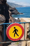 Forbidden sign at the road to ocean Stock Photo