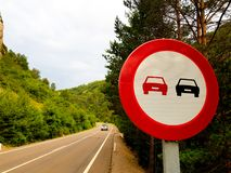 Forbidden signal overtaking on a road wit a vehicle.  royalty free stock image