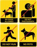 Forbidden signs. Set of yellow and black signs. Forbidden, prohibitory. No dogs. Do not photograph. No pets allowed. Don't run. No photography Stock Photo