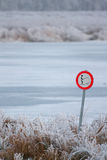 Forbidden to fish in the frozen lake. In Holland Stock Photos