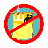 Forbidden to smoke in bed. Red sign prohibiting smoking. Ban smo Stock Photography