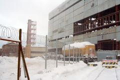 Forbidden zone. Full of snow forbidden zone and construction site with unfinished factory building Royalty Free Stock Photography