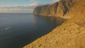 Forbidding coast of the island in the open ocean. Top view of the cliffs stock video footage