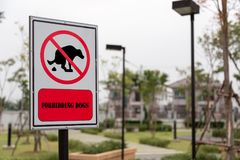 Forbidding dogs sign. In public garden stock photography