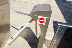 Forbidding entrance turnstile Stock Photo