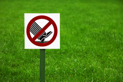 Forbidding sign on the lawn in the Park Stock Image