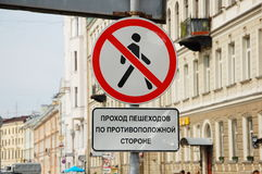 Forbidding traffic sign. Translation: pedestrian passage on the opposite side stock images
