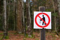 Forbiden littering sign in the forest. Please keep the environment from pollution Royalty Free Stock Images