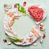 Force meat and fresh ingredients for cooking on light blue wooden background , circle frame Royalty Free Stock Photography