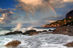 Force of Nature. Rainbow over the sea coast Stock Photography