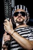 Force, Prison riot concept. Man holding a machine gun, prisoner Stock Photos