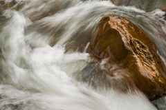 force of water on rock royalty free stock images