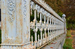 Forced perspective of rusty ornate fence with crackling paint Stock Image
