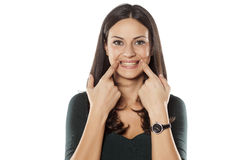 Forced smile Stock Images