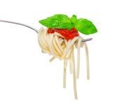 Forcella con il e-basilico della salsa di spaghetti Fotografie Stock