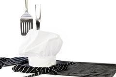 Forcella di Hat Apron Spatula del cuoco unico fotografia stock libera da diritti