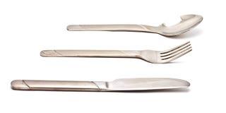 Forcella e lama del cucchiaio su bianco fotografia stock