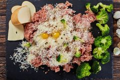 Forcemeat, broccoli, cheese, eggs, spices mixture. Raw forcemeat, broccoli, grated cheese, panko breadcrumbs, eggs, spices mixture for  meat balls or patties on Stock Photo