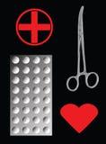 Forceps et Tablettes médicaux sur le noir Photo libre de droits