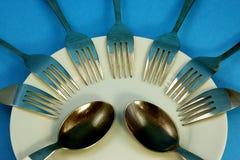 Forchetta e cucchiai Immagini Stock