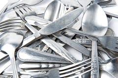 Forchetta e cucchiaio con la lama fotografia stock