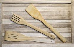 Forchette e cucchiai di legno fotografie stock libere da diritti