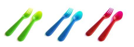 Forchette variopinte e cucchiai Fotografie Stock