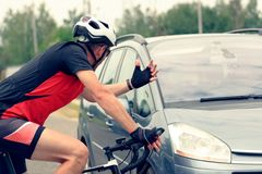 Forcing the right of way on the road. For the driver of a car with the participation of a cyclist stock image