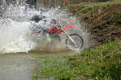 Ford. Motorcycle race on a cross-country terrain Royalty Free Stock Images