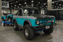 Ford Bronco and golf cart Royalty Free Stock Photos