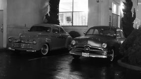 1950 Ford classic car. Classic cars parked at a beach hotel on a rainy night royalty free stock photos