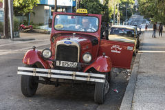 Ford Convertible early thirties taxi Havana. Red vintage Ford Convertible early thirties taxi in Central Havana, Cuba Royalty Free Stock Image