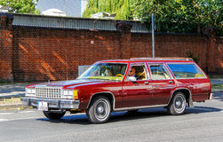 Ford Country Squire. BERLIN, GERMANY - AUGUST 12, 2014: Motor car Ford Country Squire at the city street Stock Photography