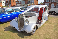 Ford customised car. Photo of a customised ford car in silver paintwork and red leather interior Stock Image