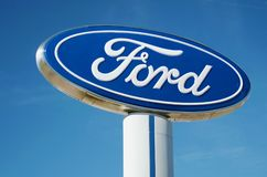 Ford Dealership Sign And Logo Against Blue Sky, Detroit, October 17, 2017. Ford sign from a dealership near Detroit, Michigan shot on a sunny clear blue day Stock Photos