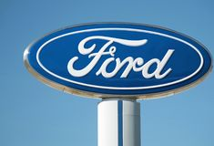Ford Dealership Sign And Logo Against Blue Sky, Detroit, October 17, 2017. Ford sign from a dealership near Detroit, Michigan shot on a sunny clear blue day Royalty Free Stock Images