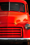 ford den gammala orange solnedgånglastbilen Arkivbilder