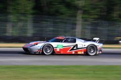Ford driver Melanie Snow. Melanie Snow races the Ford GT-Elan for the Piloti sponsored Race team at the professional motorsports racing event, International Royalty Free Stock Photography