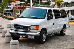 Ford E-series. ACAPULCO, MEXICO - MAY 28, 2017: White van Ford E-series in the city street royalty free stock images