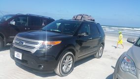 Ford Explorer on the Beach Royalty Free Stock Photos