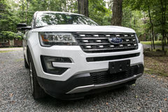 Ford explorer. Pocono Lake, Pennsylvania, July 7, 2016: A white 2016 Ford Explorer is parked on a gravel driveway in a forested area Royalty Free Stock Photo