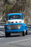 1948 Ford F5 Truck driving on country road. Adelaide, Australia - September 25, 2016: Vintage 1948 Ford F5 Truck driving on country roads near the town of Stock Images