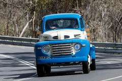 1948 Ford F5 Truck driving on country road. Adelaide, Australia - September 25, 2016: Vintage 1948 Ford F5 Truck driving on country roads near the town of Royalty Free Stock Photos