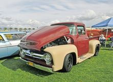 Ford F-100. This is a 1956 Ford F-100 which was the designation for half ton capacity. Later, Ford introduced the F-150 as an upgrade and subsequently dropped Stock Photography
