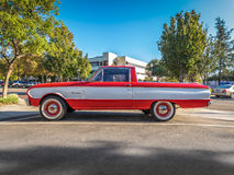 1963 Ford Falcon Ranchero. Claremont, CA, USA - Nov 5, 2016: Rare vintage red and white 1963 Ford Falcon Ranchero exhibited in Claremont village under clear Royalty Free Stock Images